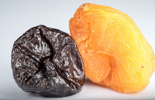 Dried apricots prunes dried fruits yellow black fruit sweet east 1166233
